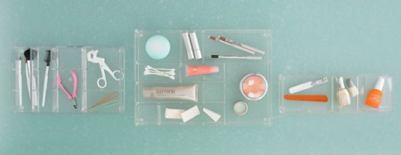 The same acrylic trays shown as cosmetic trays.