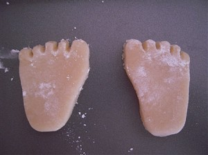 Baby feet cookies closeup